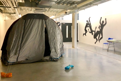 Tent + chalk outlines on the wall